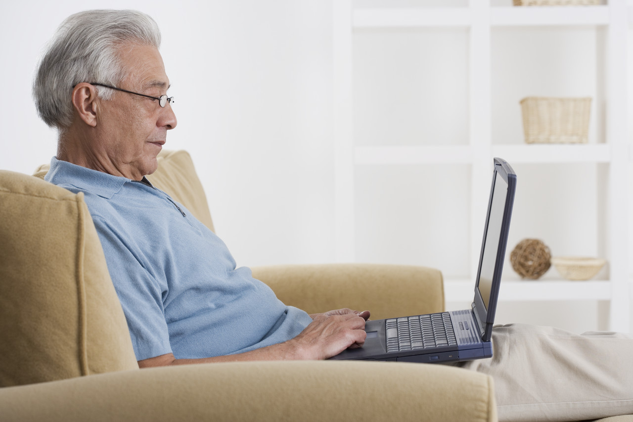 Senior Man Using Laptop --- Image by © Royalty-Free/Corbis